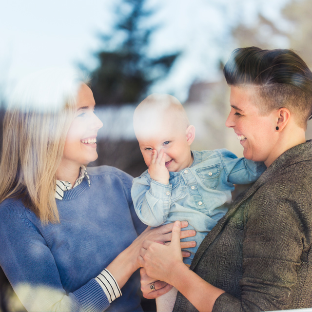 Lesbian couple happy with a baby