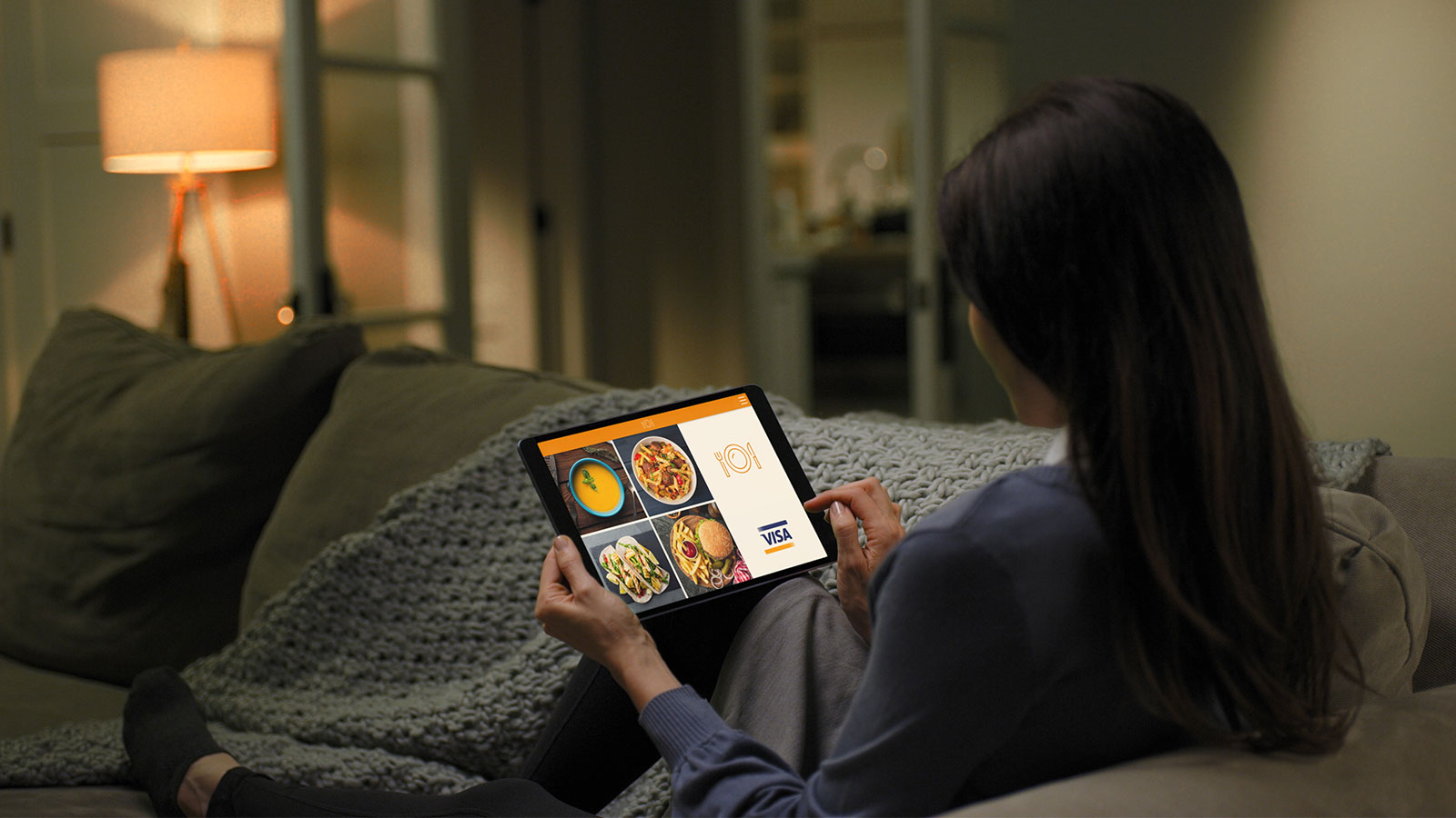 lady using tablet on couch